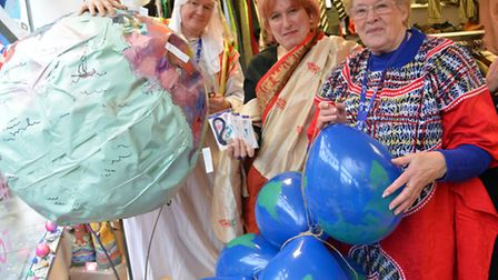 World Cancer Day event at the Ely shop Cancer Research UK, (l-r) volunteers Mark Constable, Elizabet