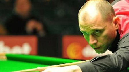 Joe Perry is through to the second round of the Ladbrokes World Gran Prix after beating Barry Hawkin