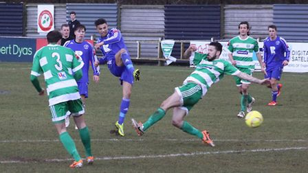 Salim Relizani fires a shot on goal in Soham Town Rangers' 3-0 defeat to Thamesmead Town.