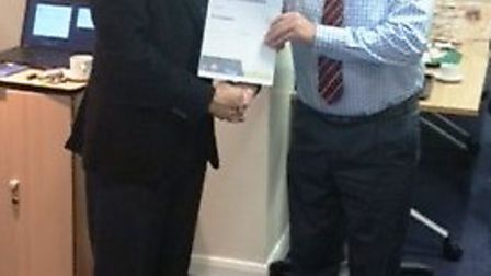 March Town Cricket Club chairman Les Mills (left) receives his NatWest Outstanding Contribution to C