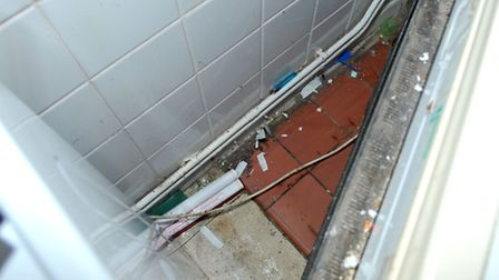 Homeless Hostel, March. Dirt behind chest freezer. Picture: Steve Williams.