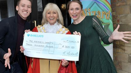 Dan Bell and Katherine Hickmott from KD Theatre Productions present a cheque to Mayor of Ely, Liz Ev