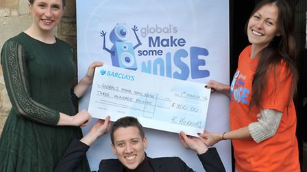 Dan Bell and Katherine Hickmott from KD Theatre Productions present a cheque to Kelly Blades from Gl