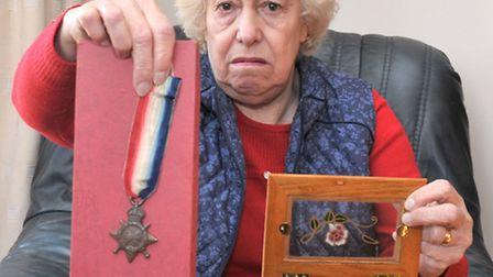 Joyce Young, holding one of her father's three World War One medals - two of which were stolen from