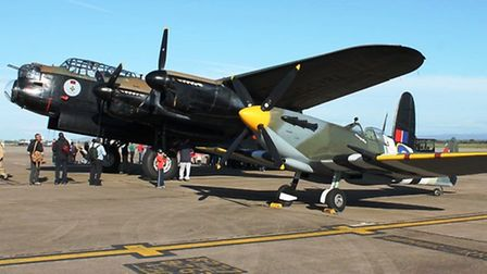 Spitfire next to a Canadian Lancaster bomber