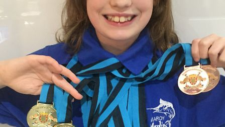 Jessica Shaw with her 12 medals she won at the ASA County Championships.