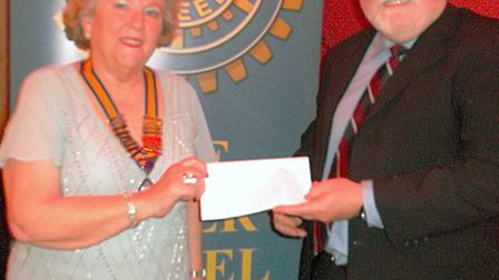 President Diana Goldstein presenting cheque to Richard Morley of CamSAR.