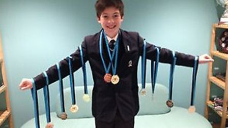 George Goodfellow with his 11 medals.