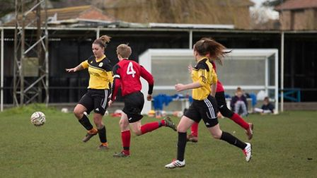 Chelsea Munday lines up her match-winning attempt on goal for March Town Ladies.