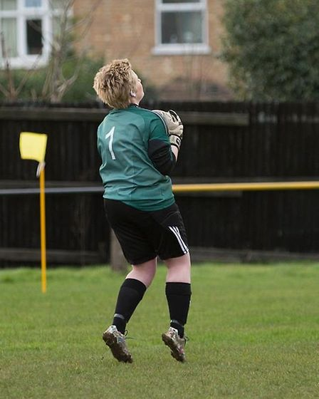 March Town Ladies' goalkeeper Tori Sharpe catches well from a Wisbech Town shot.