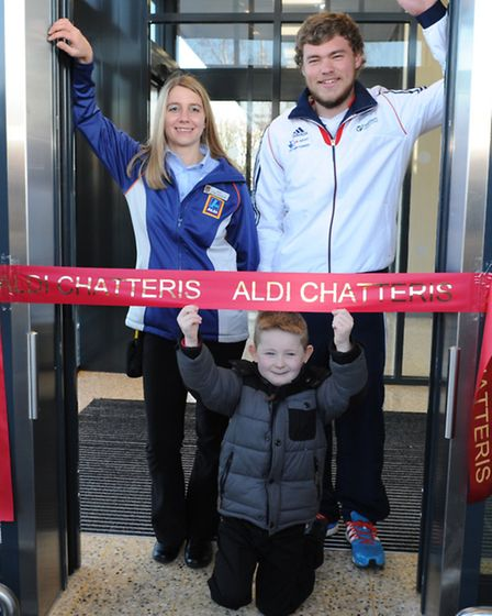 Vicky Jones store manager with Team GB Athlete Bradley Denny and Logan Brookes at ribbon cut at Aldi