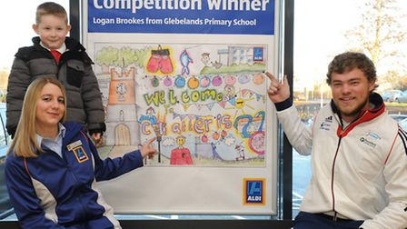 Logan Brookes of Glebelands School with his winning poster at Aldi with GB Athlete Bradley Denny and