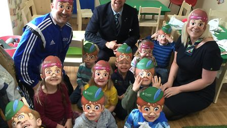 David Boyce (back, centre) and Steph Ross (back, right) with youngsters from Blackberry Day Nursery.