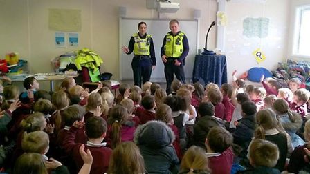 PCSOs Ian Hawkins and Jo Andow talk to pupils at the Isle of Ely Primary School.