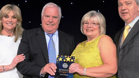 Peter and Margaret Fenn collecting their award