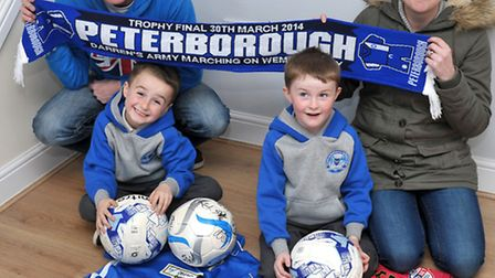 Family whose house was ruined by fire in Whittlesey. POSH players donated a load of kit to their two