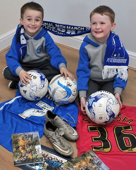 Family whose house was ruined by fire in Whittlesey. POSH players donated a load of kit to their tw