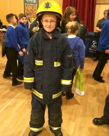 Careers Fair in Wisbech - trying out the uniform