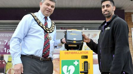 Defibrillator at Ellingham Avenue convenience store, March. Left: March town Mayor, Rob Sloulding an