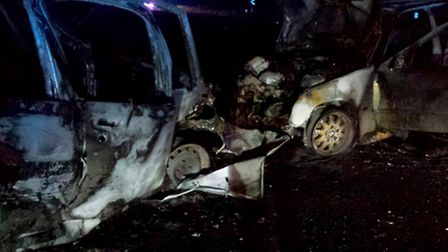 What is left of two cars after a potentially fatal accident sits on the side of the road May 12, 201