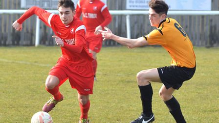 Matty Simpson races clear in Ely City's 2-1 win over Stowmarket Town. Pictures: Helen Drake