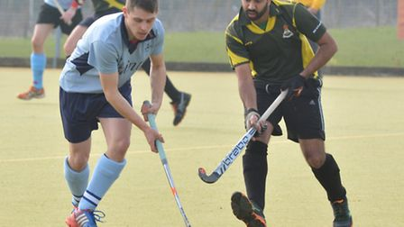 Ely City men's 1sts captain Feroze Abbas battles for possession in his side's encounter with St Neot