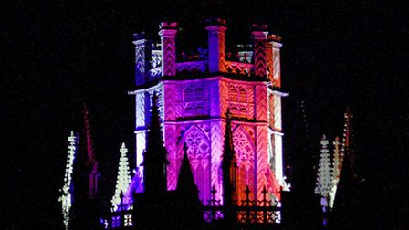Ely Cathedral's octagonal tower was lit up in red, white and blue to celebrate the Queen's 90th birt