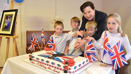 Acremont House Tea Party, to celebrate the Queen's 90th birthday, House Captains cut the cake with P