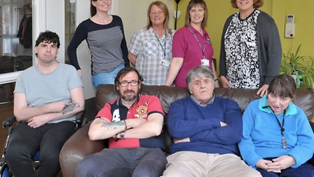 Larksfield Transitions Unit - Wisbech. Service users and staff in the community room. Left: Staff Me