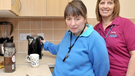Larksfield Transitions Unit - Wisbech. Jane making a cup of coffee with the help of staff member Sal