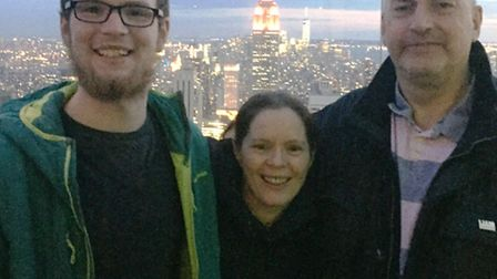 Callum Fairhurst reunited with his parents Mark and Sarah in New York after his epic journey