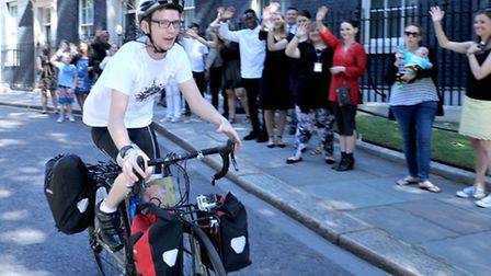 Callum Fairhurst outside number 10 Downing street. His latest cycling challenge from the gates of Do