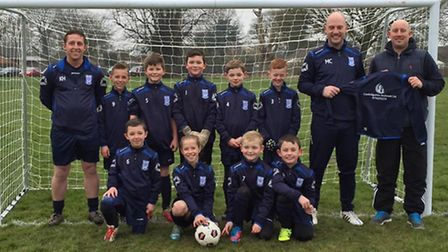 March Soccer School under 9s are presented with their newly-sponsored kit by Gary White of Cambridge