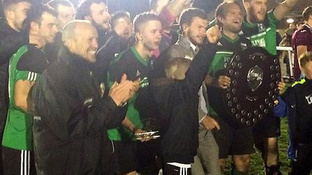 Littleport Town celebrate their Creake Charity Shield success after a 2-1 win over Eaton Socon Reser