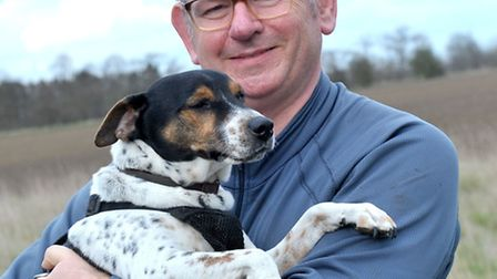 Dr Andrew Wordsworth and his dog doing charity walk for palliative care services in Fenland/Arthur r