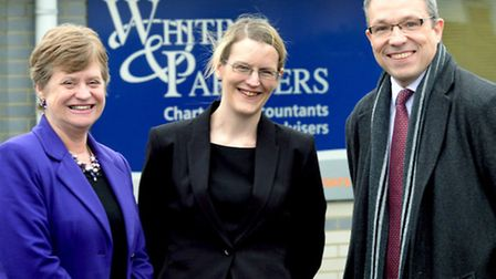 Amanda Newman (centre) is welcomed by W&P partners Barbara Nicholas and Ian Piper.