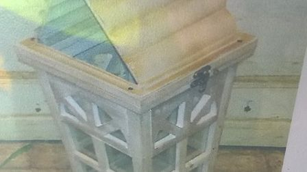 The wooden display lantern that was stolen from outside Elizabeth's Florist, High St, Chatteris duri