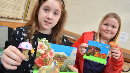 Molly-Rose, and Poppy, with their gardens as part of Ely Museum's 'Down the Bottom of the Garden' cr