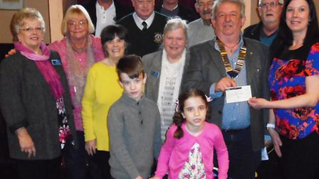 Sophie along with her brother and mum being presented with the cheque by Wisbech Lions President Bil