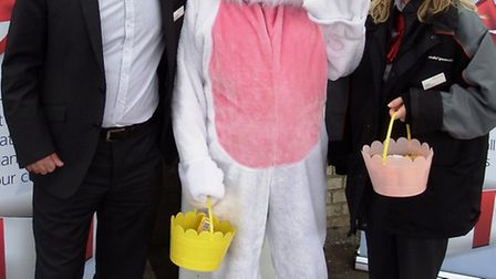 Managing Director Jamie Burles, Jon Kirby (dressed as an Easter bunny) and Angela Oxley at Ely stati