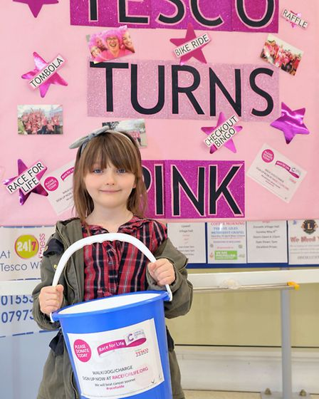 Tesco Turn's PINK weekend, Lia Twiddy age 6, helping with collection. Picture: Steve Williams.