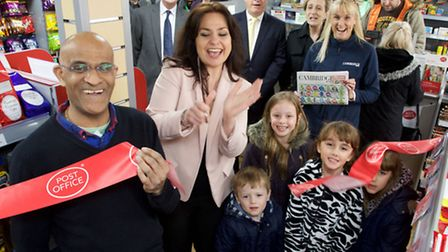 """Heidi Allen, MP for South Cambridgeshire """"cut the ribbon"""" on Friday 11 April with new postmaster Mr"""