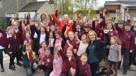 Isleham CoE Primary school celebrate their good Ofsted Report, with (centre) retired head teacher Ni
