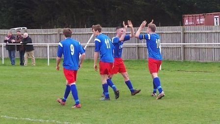 James Seymour (far right) celebrates his goal in Ely City's 4-0 triumph over Braintree Town Reserves