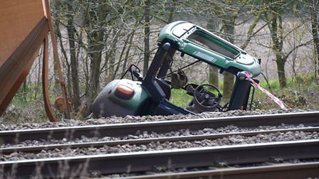 Emergency and investigation teams at Roudham after a train hit a tractor on a level crossing and the