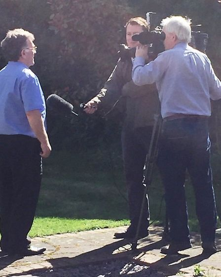 John Elworthy, editor of the Cambs Times newspaper, being interviewed about this morning's arrest