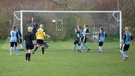 Shannon Kelly thunders in March Town Ladies' second goal in their 2-1 victory over Swinehead Ladies.