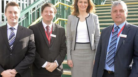 Abellio Great Anglia's Paul Oxford, James Steward and Colin MacConnachie with MP Lucy Frazer at Kenn