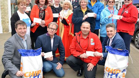 Presentation of Isle of Ely potato race cheques, (front left) Isle of Ely Produce Director Oliver Bo