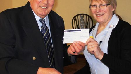 Rotarian Mike Bentley with Sheila Jeffery of Marie Curie